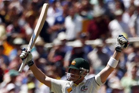 Australia's Brad Haddin celebrates his century during the second day's play in the second Ashes cricket test against England at the Adelaide Oval