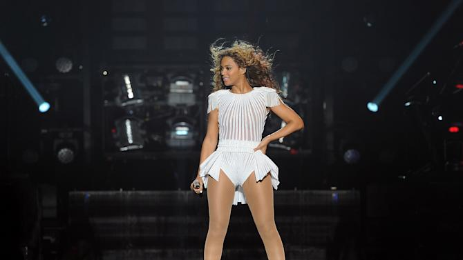 """IMAGE DISTRIBUTED FOR PARKWOOD ENTERTAINMENT - Singer Beyonce performs on her """"Mrs. Carter Show World Tour 2013"""", on Wednesday, April 24, 2013 at the Palais Omni Sport Bercy in Paris, France. Beyonce is wearing a custom hand beaded peplum one-piece by Ralph & Russo with shoes by Stuart Wieztman. (Photo by Frank Micelotta/Invision for Parkwood Entertainment/AP Images."""
