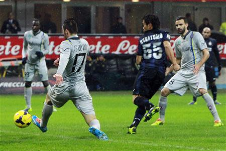 Inter Milan's Nagatomo shoots to score against Chievo during their Italian Serie A soccer match in Milan