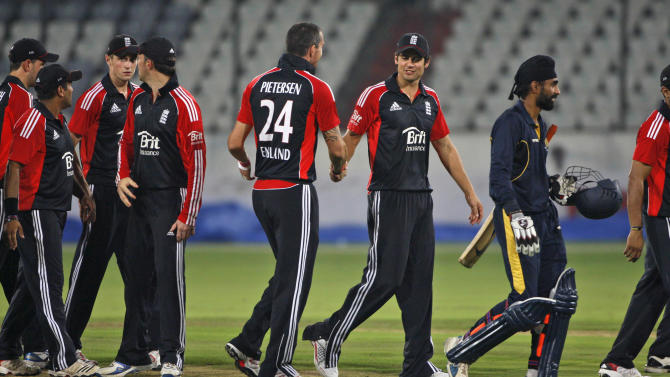 England's cricket captain Alastair Cook, center right, celebrates his team's victory with Kevin Pietersen, center left, after a practice match against Hyderabad XI in Hyderabad, India, Saturday, Oct. 8, 2011. (AP Photo/Mahesh Kumar A.)