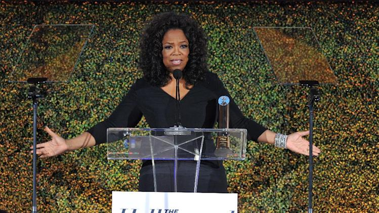 IMAGE DISTRIBUTED FOR THE HOLLYWOOD REPORTER - Oprah Winfrey attends THR's celebration of power 100 women in entertainment breakfast on Wednesday, Dec. 11, 2013 in Beverly Hills, Calif. (Photo by Vince Bucci/Invision for The Hollywood Reporter/AP Images)