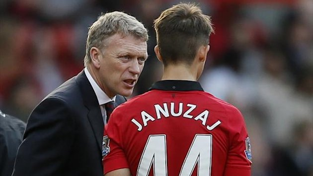 Manchester United manager David Moyes (L) talks to Adnan Januzaj during their English Premier League soccer match against Southampton at Old Trafford in Manchester, northern England October 19, 2013. (Reuters)