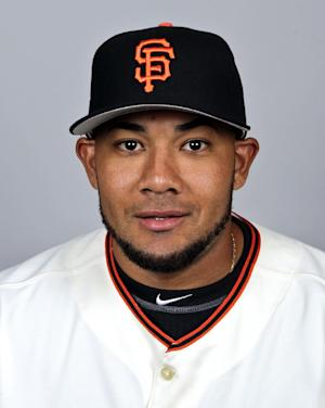 FILE - In this March 1, 2012, file photo, San Francisco Giants' Melky Cabrera poses in a baseball uniform in Scottsdale, Ariz. The busy Blue Jays struck again Friday, Nov. 16, 2012, with their latest big deal: All-Star game MVP Cabrera is set to join them upon his return from a drug suspension. (AP Photo/Morry Gash, File)