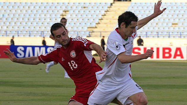 LEBANON, Beirut : Lebanon's defender Walid Ismail (L) challenges Iran's forward Mohammad Reza Khalatbari during their 2014 World Cup Asian zone group A qualifying football match at Sports City Stadium in Beirut on September 11, 2012 (AFP)
