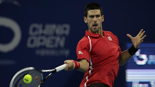 Serbia&#39;s Novak Djokovic hits a shot during his match against Germany&#39;s Michael Berrer at the China Open (Reuters)