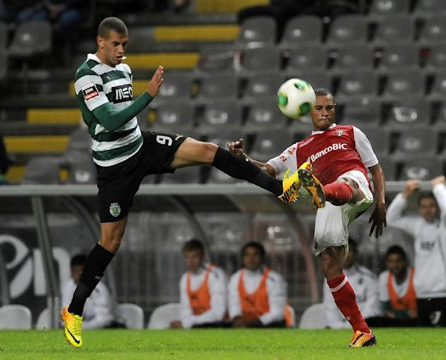 Sporting's Islam Slimani, left, from Algeria, challenges Sporting Braga's Wanderson Baiano, from Brazil, during their Portuguese League soccer match at the Municipal Stadium, in Braga, Portugal, Satur