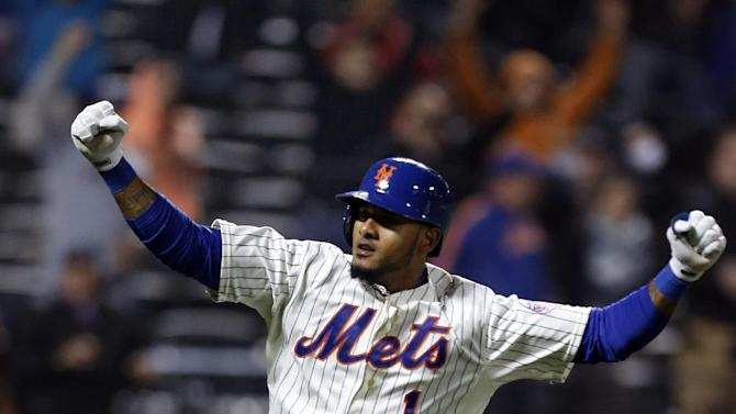 New York Mets' Jordany Valdespin (1) reacts after hitting a 10th-inning, walk-off grand slam off Los Angeles Dodgers relief pitcher Josh Wall (46) in a baseball game at Citi Field in New York, Wednesday, April 24, 2013. The Mets won 7-3. (AP Photo/Kathy Willens)