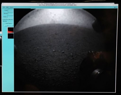 An image transmitted from the Curiosity Rover of the vehicle's wheel on Mars