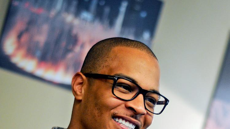 In this Sept. 10, 2012 photo, rapper T.I. is photographed during an interview in Atlanta. Even though T.I. has not produced any major hits lately, the Grammy-winning rapper believes he can still sell a considerable amount of albums based on his stellar track record. (AP Photo/Kat Goduco)