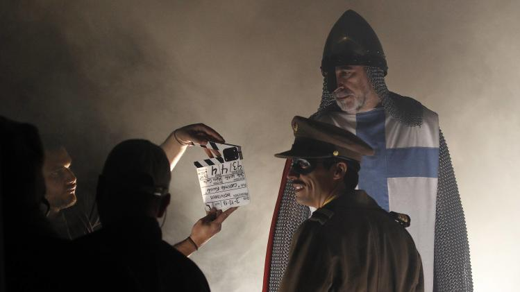 "Portuguese actors Waddington and Duraes react during the filming of ""Capitao Falcao"" in Lisbon"