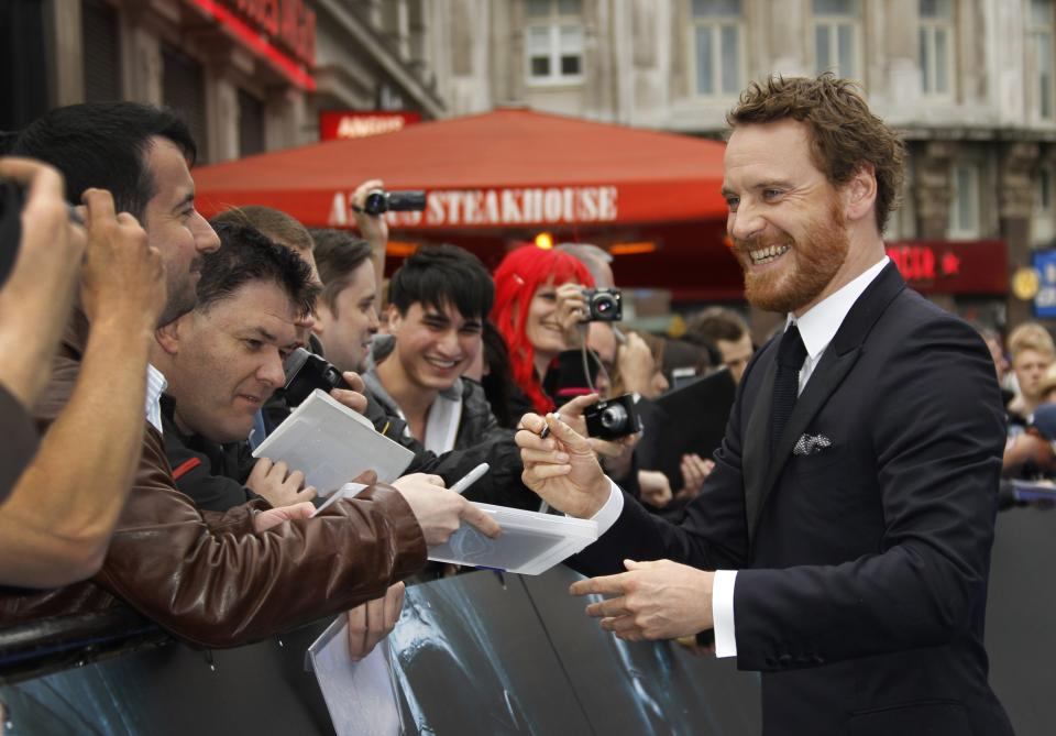 Actor Michael Fassbender smiles at fans as he arrives at a central London cinema for the World Premiere of Prometheus, Thursday, May 31, 2012. (AP Photo/Joel Ryan)