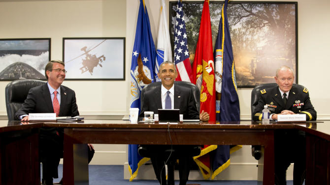 Defense Secretary Ash Carter, left, President Barack Obama, and Chairman of the Joint Chiefs of Staff Gen. Martin Dempsey, arrive for an update on the Islamic State group at the Pentagon on Monday, July 6, 2015. (AP Photo/Jacquelyn Martin)