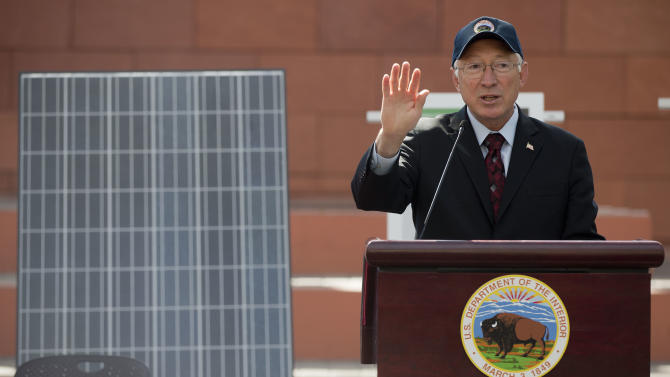 """Interior Secretary Ken Salazar speaks during a news conference, Friday, Oct. 12, 2012, in Las Vegas, in which he and Senate Majority Leader Harry Reid announced a plan that sets aside 285,000 acres of public land for the development of large-scale solar power plants. The government is establishing 17 new """"solar energy zones"""" on 285,000 acres in six states: California, Nevada, Arizona, Utah, Colorado and New Mexico. Most of the land,153,627 acres, is in Southern California. (AP Photo/Julie Jacobson)."""
