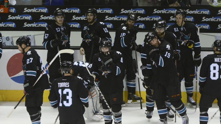Sharks players react after losing to the Kings in the first round of the playoffs. San Jose led the series 3-0 before losing four straight games. (USA Today)