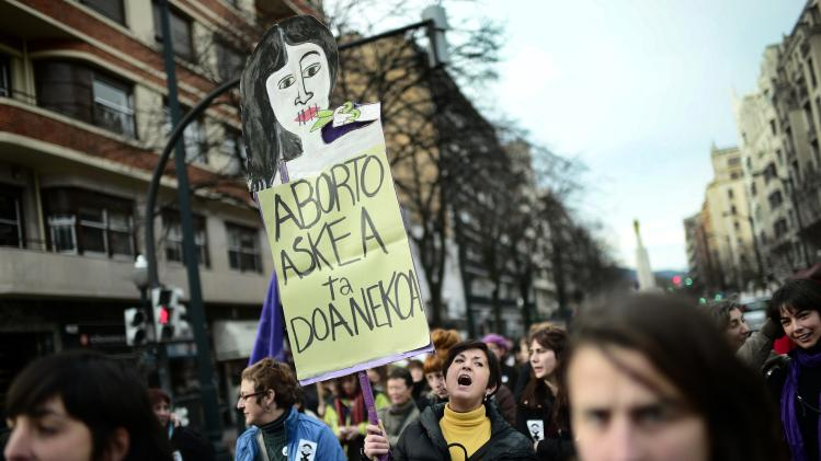A demonstrator carries a sign during a pro-choice protest in Bilbao