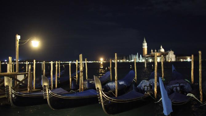 Gondolas are seen in the Venetian lagoon in front of St.Mark square