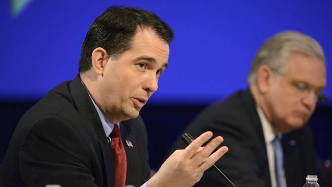 Wisconson Govenor Walker attends a National Governors Association discussion during its Winter Meetings in Washington