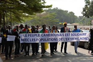"People hold a banner reading ""The Cameroonian …"