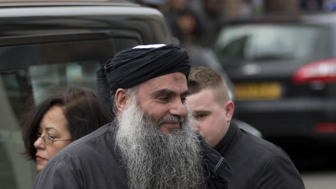 Abu Qatada arrives back at his residence in London after being freed from prison, Tuesday, Nov. 13, 2012.  The radical Islamist cleric described by prosecutors as a key al-Qaida operative in Europe was freed from prison Tuesday after a court ruled he cannot be deported from Britain to Jordan to face terrorism charges.  (AP Photo/Matt Dunham)