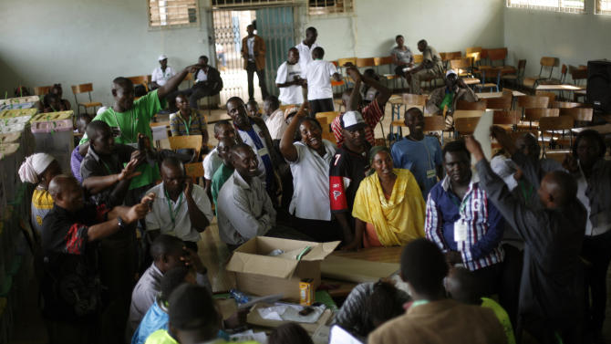 Kenyan election volunteers cheer as they wrap up the counting of ballots for Monday's general election at St Theresa Girl School, used as a polling and counting station, in the Mathare area of Nairobi, Kenya, Wednesday, March 6, 2013. Kenya on Monday held its first presidential election since the 2007 vote which ushered in months of tribal violence that killed more than 1,000 people and displaced 600,000 from their homes. Election officials in Kenya began counting ballots by hand on Wednesday after the early returns electronic system broke down, while a top presidential candidate levied charges against Britain's high commissioner that the U.K. is meddling in the vote. (AP Photo/Jerome Delay)