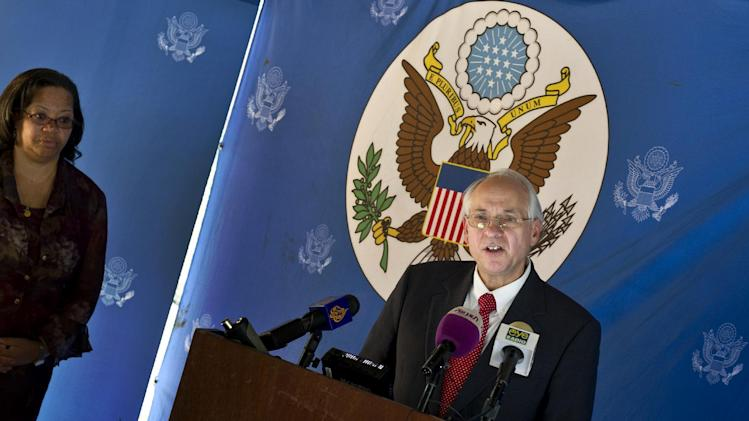 The  United States special envoy to South Sudan Donald Booth speaks to the media, as U.S. Ambassador to South Sudan Susan D. Page, left, listens in Juba, South Sudan, Tuesday, Dec. 31, 2013. Booth told The Associated Press Tuesday that the  country's warring factions have agreed to attend peace talks in Ethiopia and that the commitment of both sides is