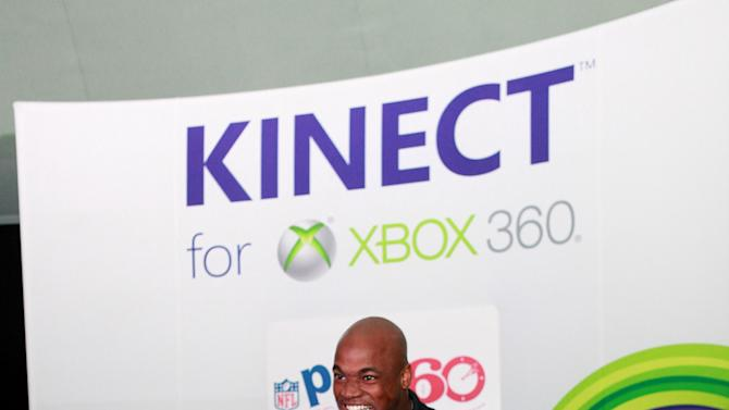 Young Duke Stein competes against NFL running back Adrian Peterson at Kinect for Xbox 360, on Thursday, Jan. 31, 2013 in New Orleans, LA. (Photo by Barry Brecheisen/Invision for Xbox/AP Images)