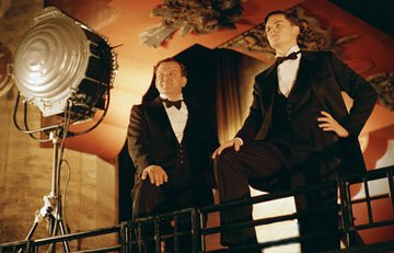 John C. Reilly as Noah Dietrich and Leonardo DiCaprio as Howard Hughes in Miramax Films' The Aviator