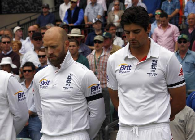 England's captain Cook and vice-captain Prior observe a minute of silence to commemorate former South African President Mandela's death before starting second day's play in second Ashes cr