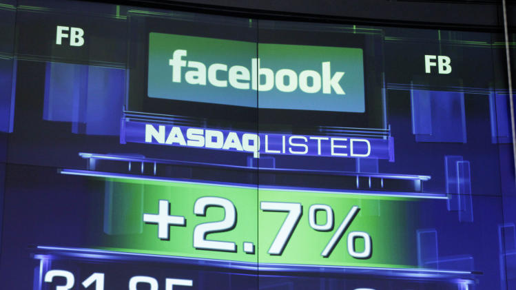 FILE- This Wednesday, May 23, 2012, file photo, shows the pre-market price for Facebook at the Nasdaq MarketSite in New York. The Nasdaq stock exchange said Wednesday that it plans to hand out $40 million in cash and credit to reimburse investment firms that got ensnared by technical problems with trading Facebook stock. (AP Photo/Mark Lennihan, File)