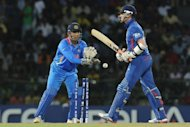 England&#39;s Graeme Swann (R) is dismissed by India&#39;s Mahendra Singh Dhoni during their World Twenty20 match on September 23. &quot;But they are a very good side that has done really well in the last year. So you will see them adapt to conditions and get better in the future,&quot; Dhoni said