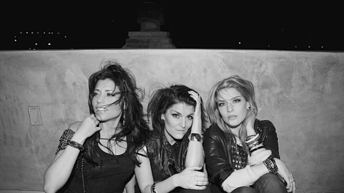 """This undated photo provided by Warner Music Group/Word Entertainment shows the platinum-selling music trio BarlowGirl, from left, Becca Barlow, Alyssa Barlow and Lauren Barlow. The band is retiring after they release their final single, """"Hope Will Lead Us On,"""" on Oct. 30, 2012. (AP Photo/Warner Music Group/Word Entertainment, Sarah Barlow)"""