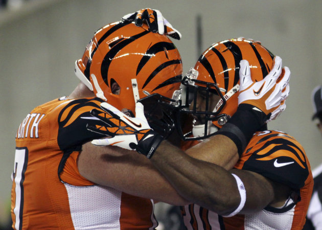 Cincinnati Bengals running back Cedric Peerman, right, is congratulated by tackle Andrew Whitworth after Peerman scored a touchdown on a five-yard run during the first half of an NFL football game aga