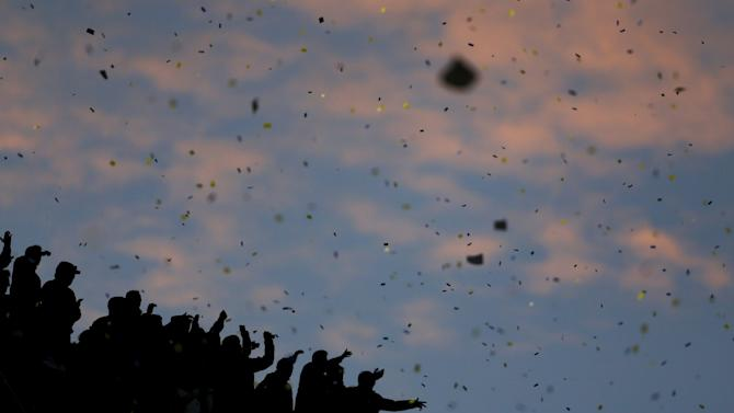 Boca Juniors' supporters are silhouetted as they cheer for their team before their Argentine First Division soccer match against River Plate in Buenos Aires