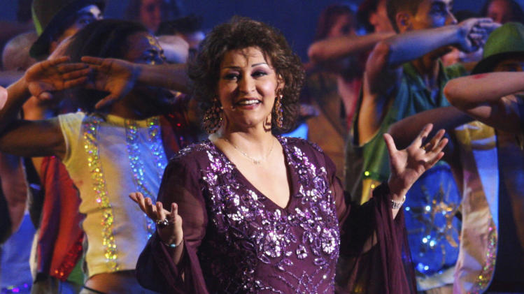 FILE - In this July 6, 2009 file photo, Arabic music diva Warda, performs during a show in Algiers, Algeria to inaugurate the second Pan-African Festival. Egyptian state TV said Warda, whose sultry voice and range helped make her one of the giants of Arab song, died Thursday, May 17, 2012 at her home in Cairo. The official MENA news agency said she was 72, and that her body will be flown to Algeria on Friday for burial. (AP Photo/Alfred de Montesquiou, File)