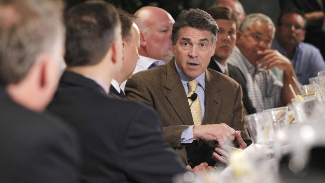 Republican presidential candidate, Texas Gov. Rick Perry meets with business leaders at a lunch in Dubuque, Iowa, Tuesday, Aug. 16, 2011. (AP Photo/Charles Dharapak)