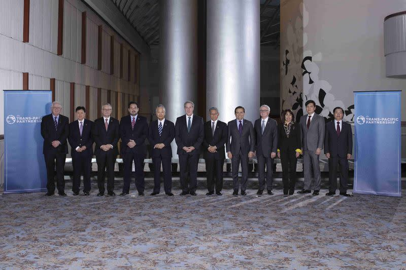 Pacific trade negotiators reach landmark deal, fight over approval looms