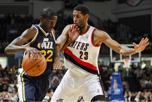 Utah Jazz shooting guard Justin Holiday (22) protects the ball from Portland Trail Blazers shooting guard Allen Crabbe (23) in the first half of a preseason NBA basketball game on Friday, Oct. 11, 201