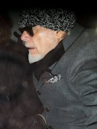 Former British rock star Gary Glitter, whose real name is Paul Gadd, returns home in central London on October 28, 2012, after he was arrested earlier in the day by British police