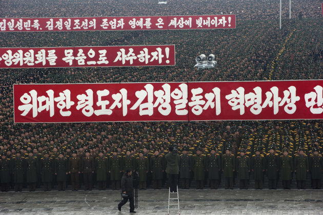 Slogans honoring the leadership are displayed during a mass rally organized to celebrate the success of a rocket launch that sent a satellite into space on Kim Il Sung Square in Pyongyang, North Korea
