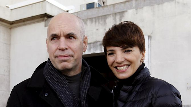 Candidate Larreta of the PRO party poses alongside his wife Barbara after voting in an election for Buenos Aires' City Mayor