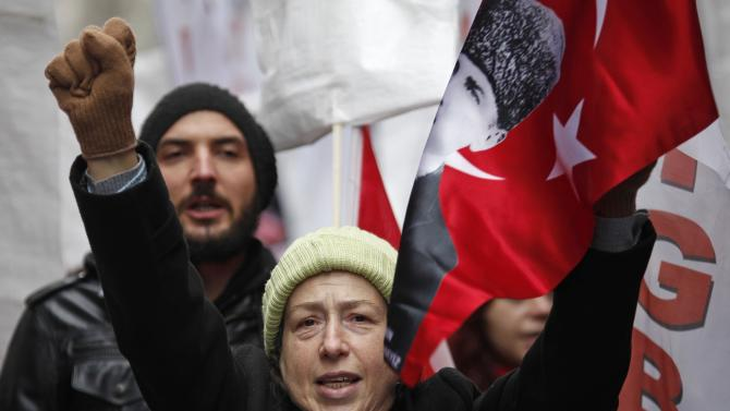 Left wing demonstrators shout anti-U.S. slogans during a protest against the visit of U.S. Vice President Biden, in central Istanbul