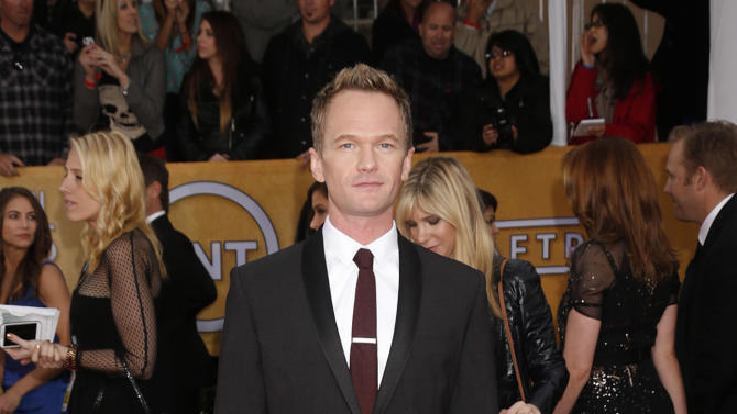 Neil Patrick Harris arrives at the 19th Annual Screen Actors Guild Awards at the Shrine Auditorium in Los Angeles on Sunday Jan. 27, 2013. (Photo by Todd Williamson/Invision for The Hollywood Reporter/AP Images)