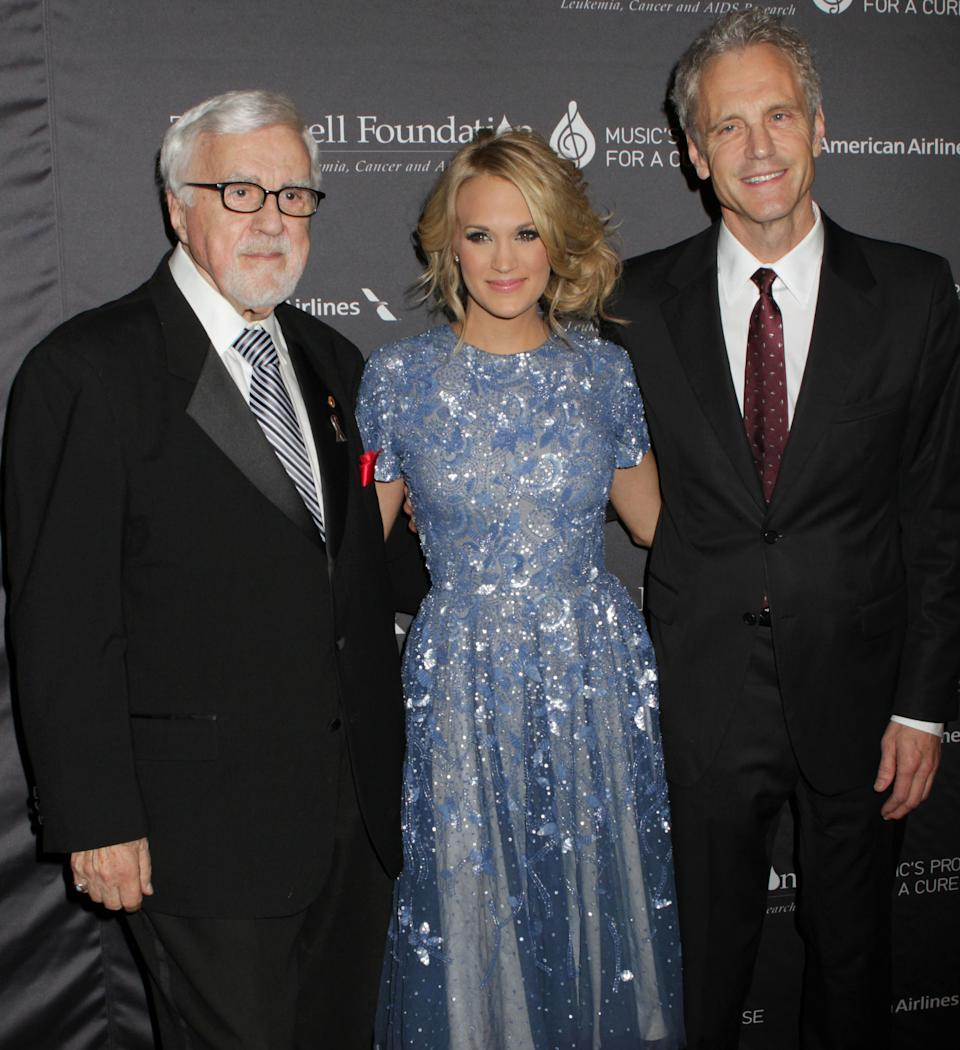 From left, Tony Martell, Carrie Underwood and John Sykes attend the T.J. Martell Foundation 38th Honors Gala, on Tuesday, Oct. 22, 2013, in New York. (Photo by Greg Allen/Invision/AP)
