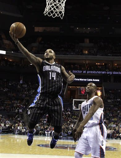 Davis, Afflalo lead Magic over Bobcats 107-98