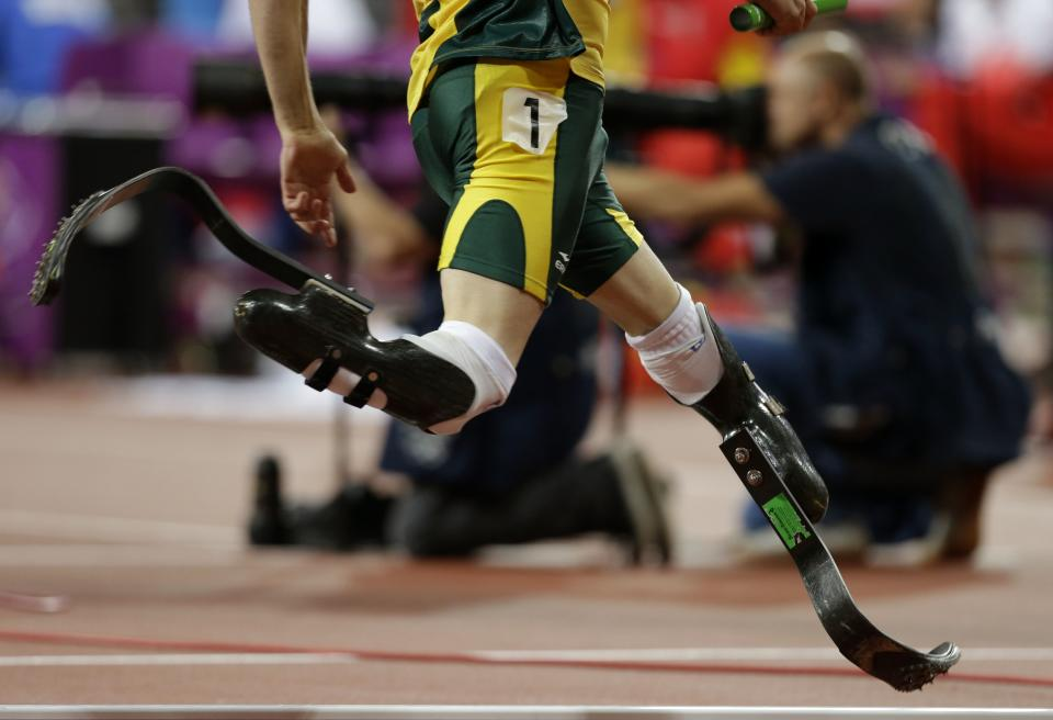 South Africa's Oscar Pistorius competes in the men's 4x400-meter relay final during the athletics in the Olympic Stadium at the 2012 Summer Olympics, London, Friday, Aug. 10, 2012. (AP Photo/Hassan Ammar)