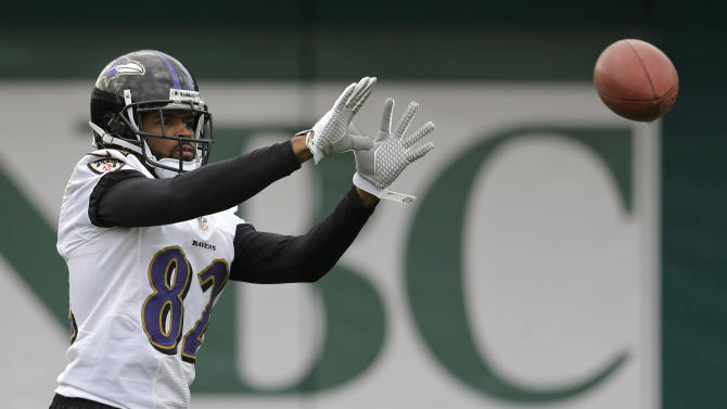 Baltimore Ravens wide receiver Torrey Smith prepares to catch a pass as he warms up during an NFL Super Bowl XLVII football practice on Wednesday, Jan. 30, 2013, in New Orleans. The Ravens face the San Francisco 49ers in Super Bowl XLVII on Sunday, Feb. 3. (AP Photo/Patrick Semansky)