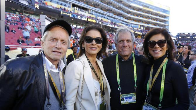 CBS Corporation Chairman Moonves and his wife Julie Chen and actors Douglas and Zeta-Jones stand on the field ahead of the NFL's Super Bowl 50 football game between the Carolina Panthers and the Denver Broncos in Santa Clara
