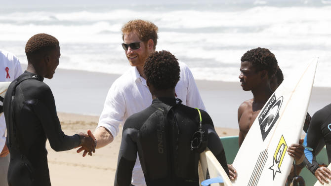 Britain's Prince Harry shakes hands with members of the Surfers not Street Children charity organization during a presentation in Durban