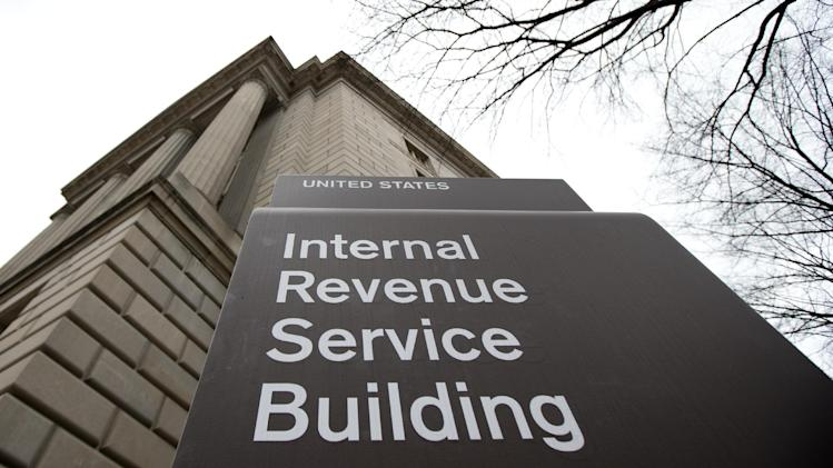 FILE - This file photo taken March 2, 2013, shows the Internal Revenue Service building at the Federal Triangle complex in Washington. Poor oversight by the Internal Revenue Service allowed workers to use agency credit cards to buy wine for an expensive luncheon, dorky swag for managers' meetings and, for one employee, romance novels and diet pills, an agency watchdog said Tuesday, June 25, 2013. (AP Photo/Manuel Balce Ceneta, File)