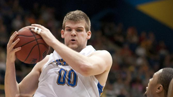 Morehead State's Drew Kelly snaps a rebound away from Murray State's Donte Poole during an NCAA college basketball game Wednesday, Jan. 18, 2012, in Morehead, Ky. (AP Photo/ John Flavell)